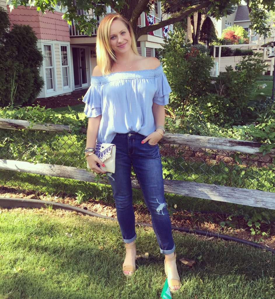 Off the shoulder top, jeans, espadrilles, and cute clutch