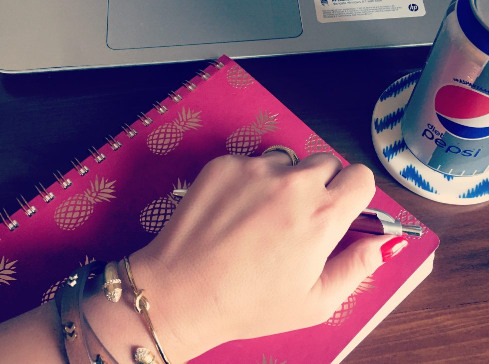 Taking notes with my cute bracelets