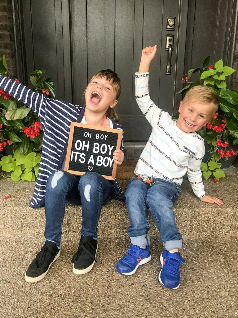happy kids sharing the baby gender reveal