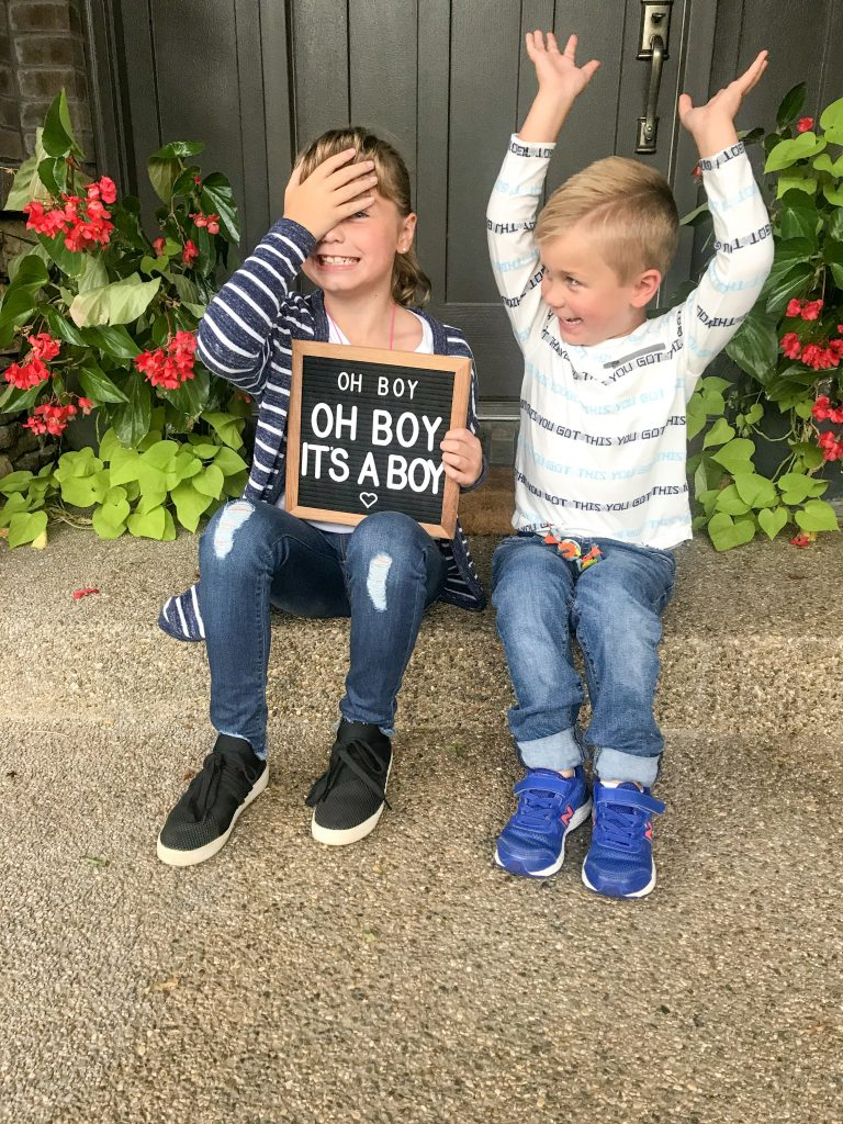 big kids sharing the baby gender reveal