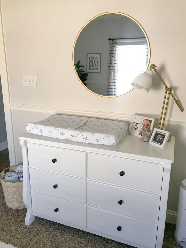 nursery dresser and round mirror